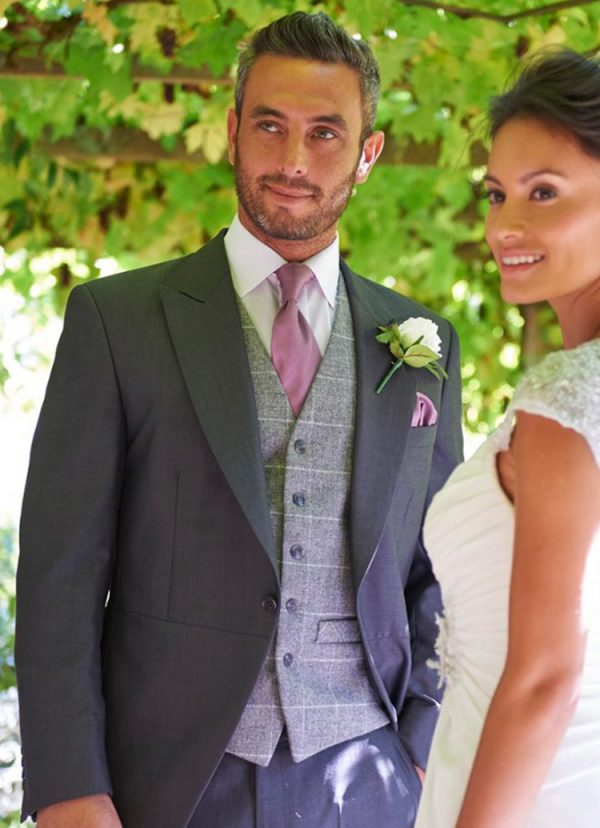 Our Hire Grey/Oink Tweed Check Waistcoats compliment Lounge Suits and Tailcoats perfectly.